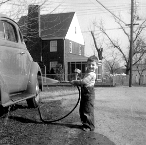 boy washing 1936 chevy coupe